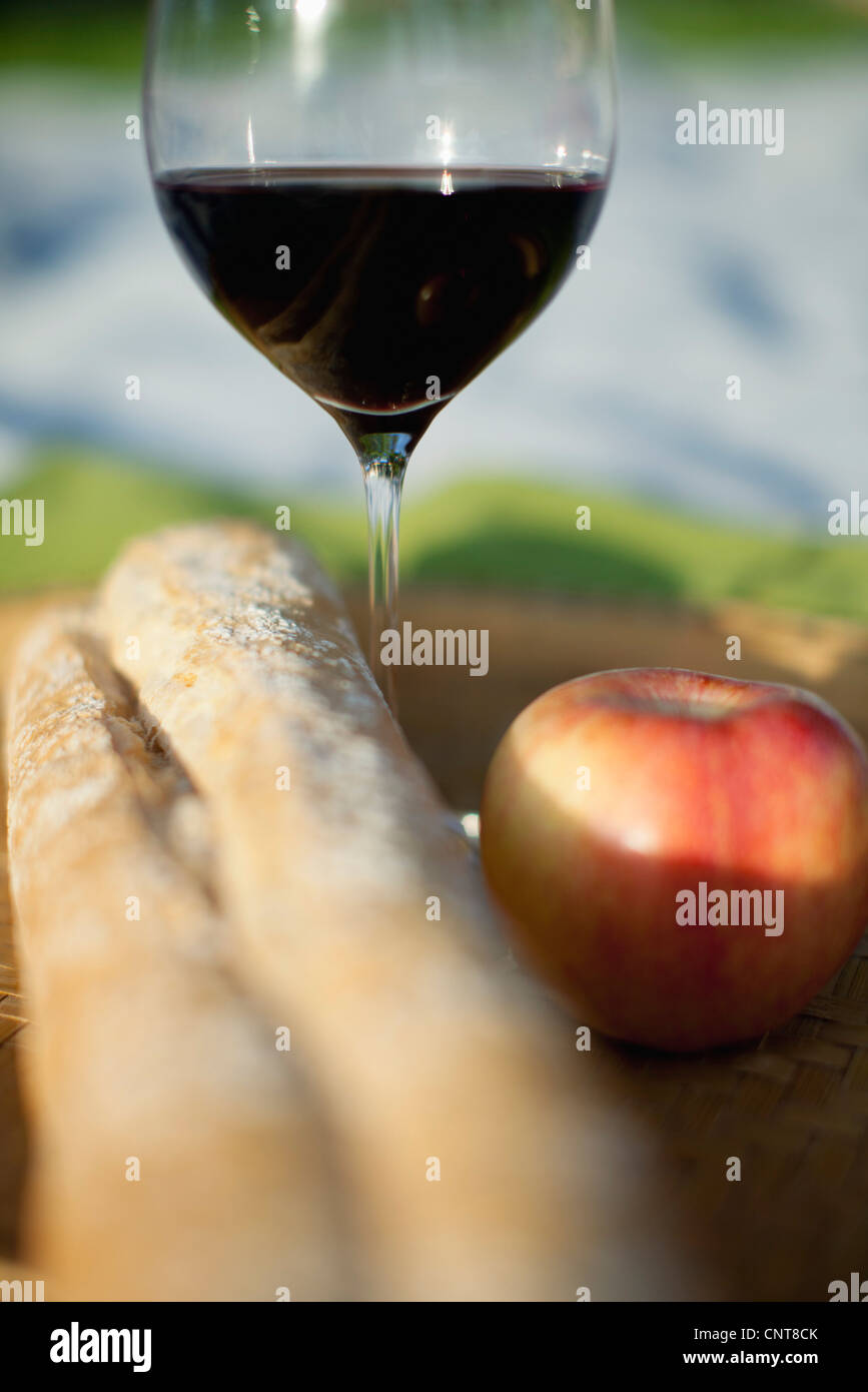 Apple, glass of wine and bread Stock Photo