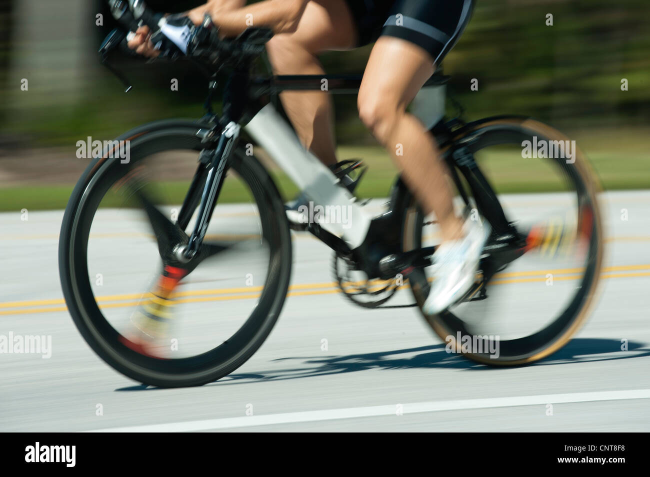 Woman riding road bike, low section - Stock Image
