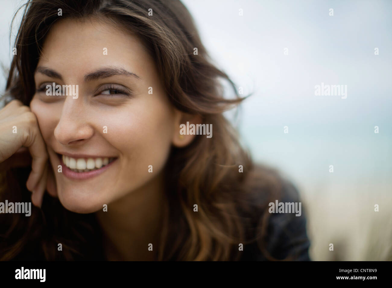 Smiling young woman - Stock Image