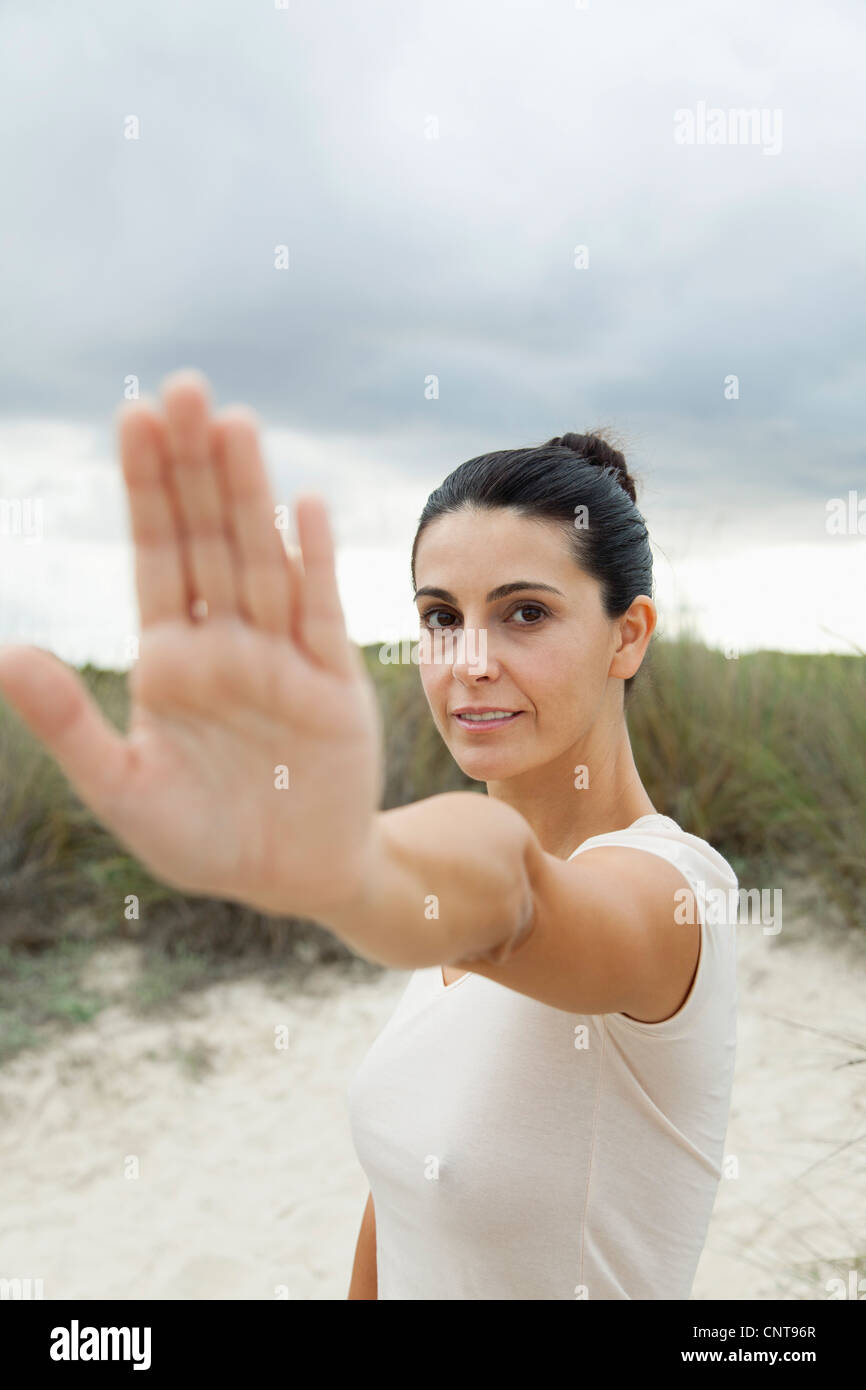 Mature woman holding up hand, selective focus - Stock Image