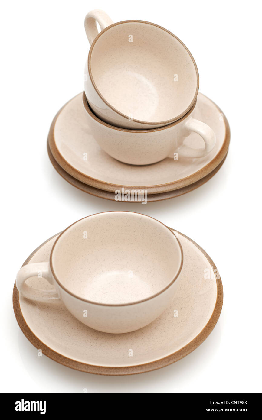 Three beige coffee cups and saucers - Stock Image