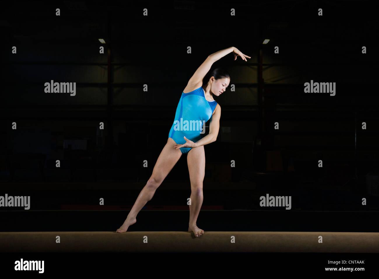 Teenage girl gymnast on balance beam - Stock Image