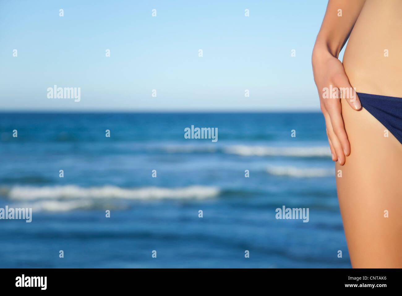 Woman in bikini bottom, cropped - Stock Image