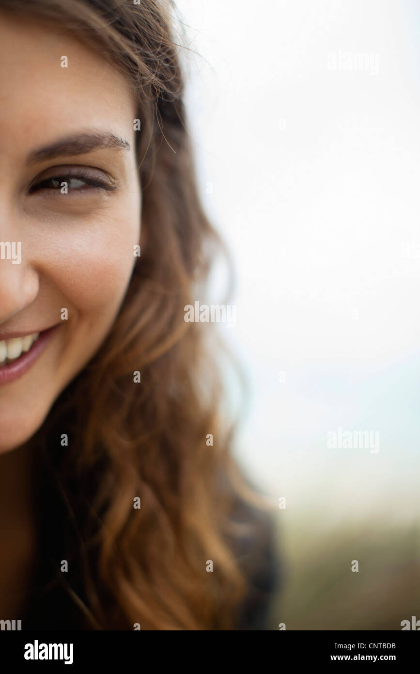 Half of young woman's face - Stock Image