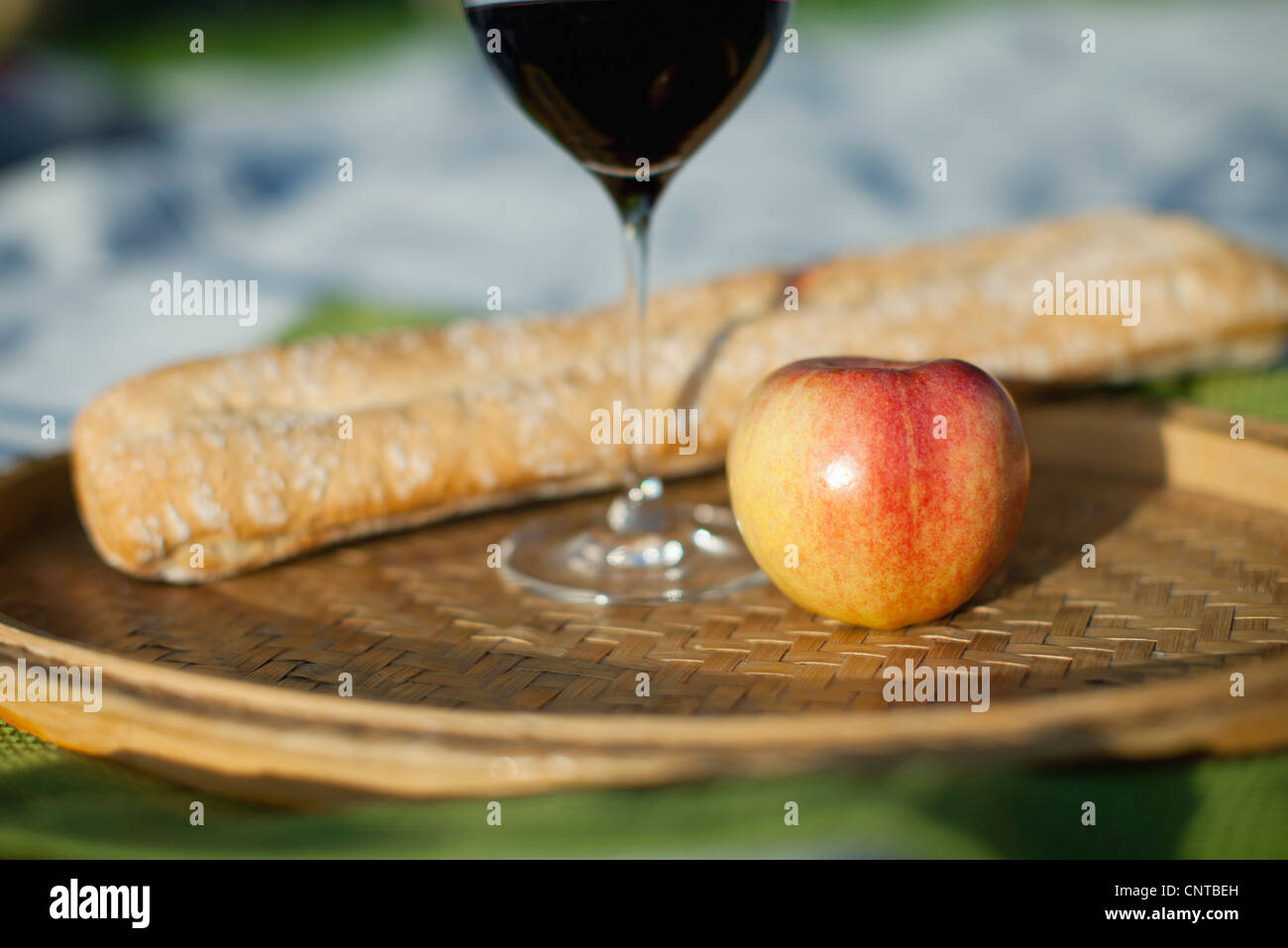 Apple, glass of wine and bread - Stock Image