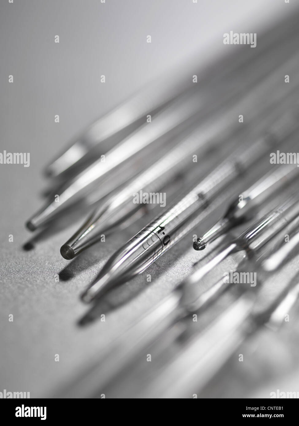 Close up of tips of pipettes - Stock Image