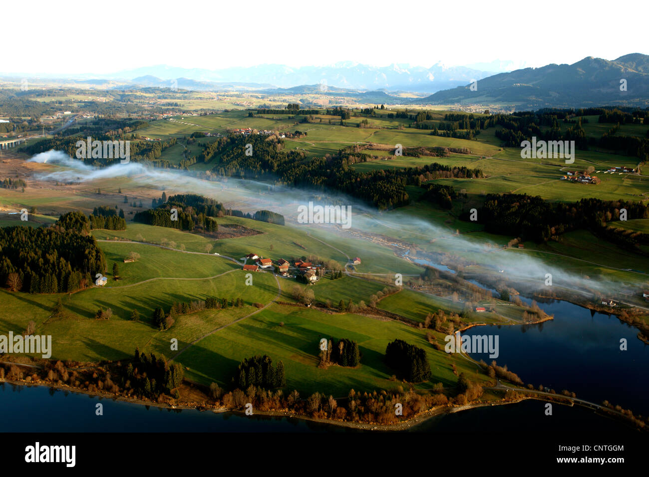 smoke at Rottach storage lake in autumn, burning fields - Stock Image