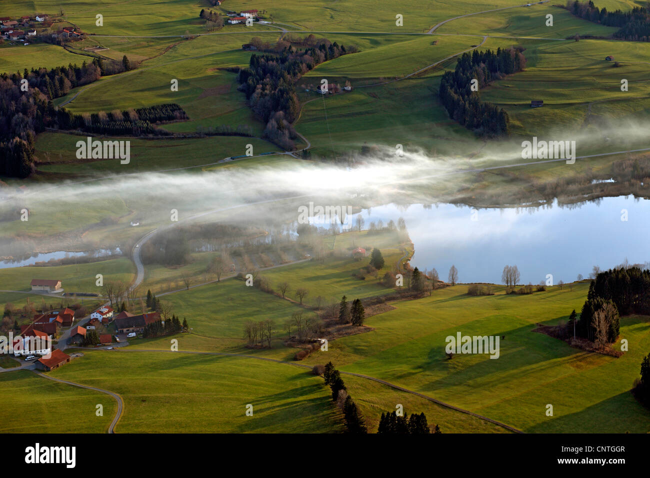 wads of smoke at Rottach storage lake in autumn, burning fields - Stock Image