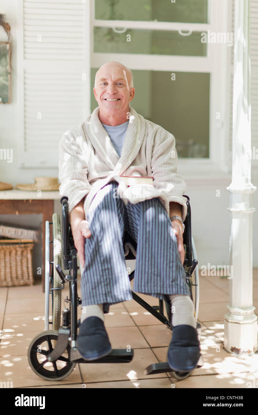 Older man sitting in wheelchair - Stock Image