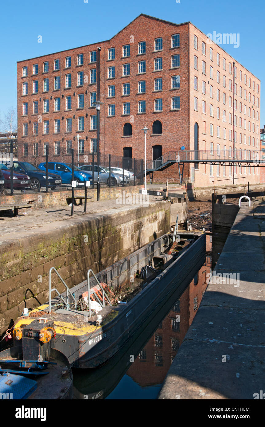 Brownfield Mill. Former cotton Mill, c1825, and a drained section of the Rochdale Canal, Ancoats, Manchester, England, - Stock Image
