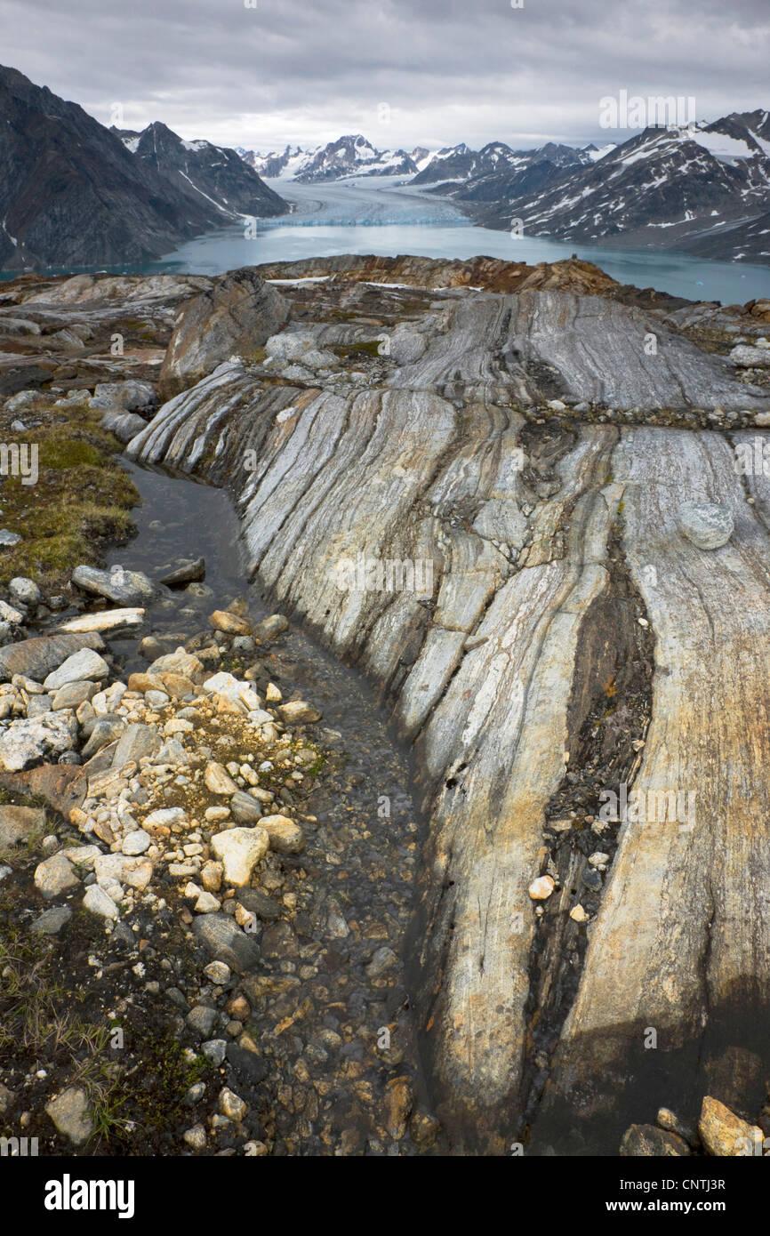 view to Sermiligaq Fjord and Knud Rasmussen Glacier, abrasion on rock, Greenland, Ammassalik, East Greenland, Sermiligaq Stock Photo