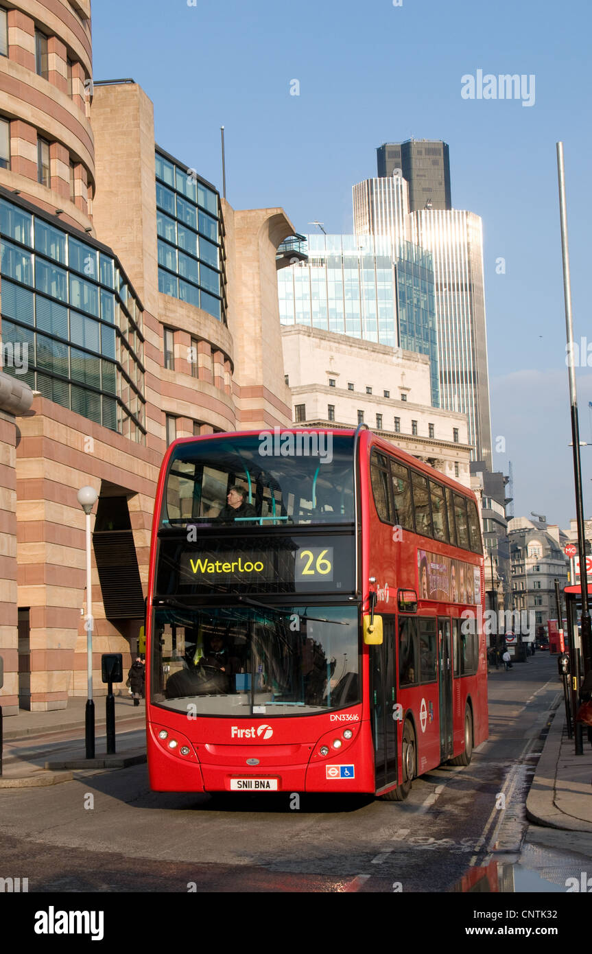 A First London Alexander Dennis Enviro 400 bus leaves the Bank junction to travel down Queen Victoria street, City - Stock Image