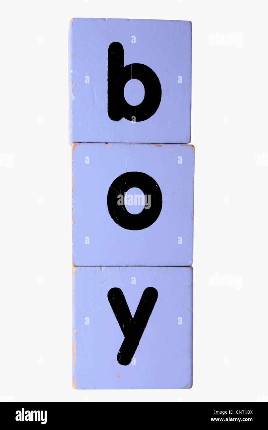 assorted childrens toy letter building blocks against a white background that spell boy with clipping path Stock Photo