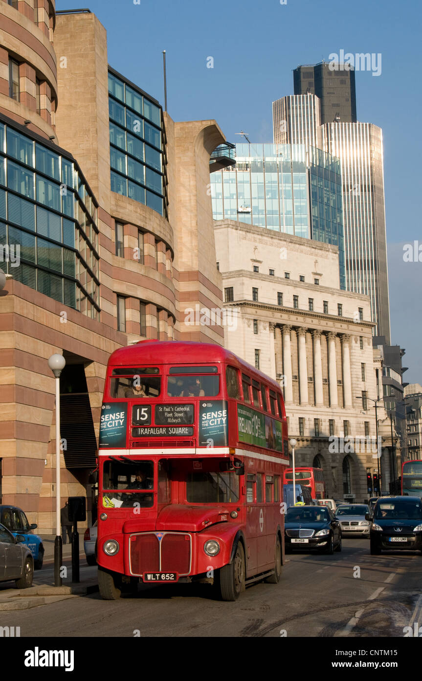 An AEC Routemaster bus on heritage route 15 has just passed through Bank junction in to Queen Victoria Street. - Stock Image