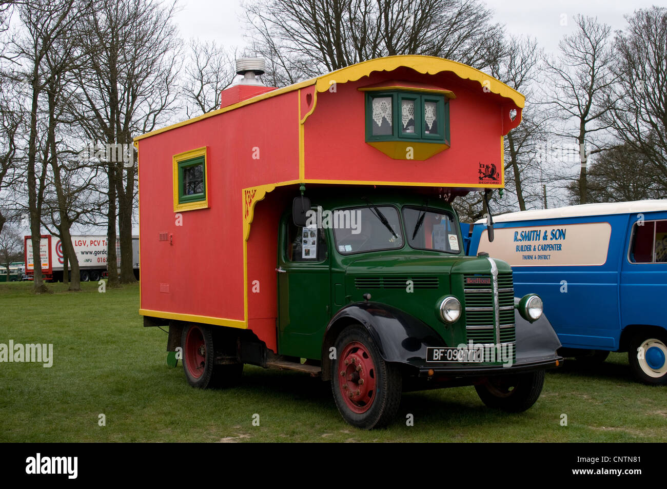 A French registered Bedford O type lorry with an ornate mobile home on the back. The vehicle was seen at a gathering - Stock Image