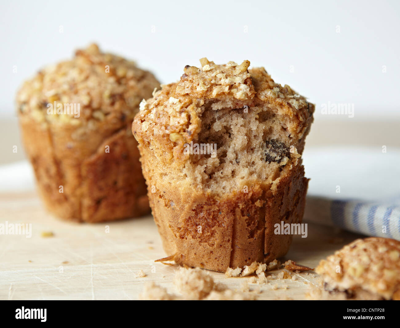 Muffin with bite taken out - Stock Image