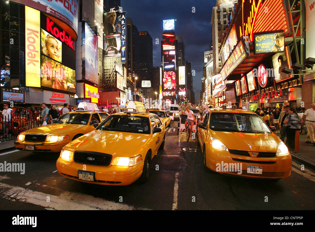 Yellow Taxicabs on Times Square, New York City, USA - Stock Image