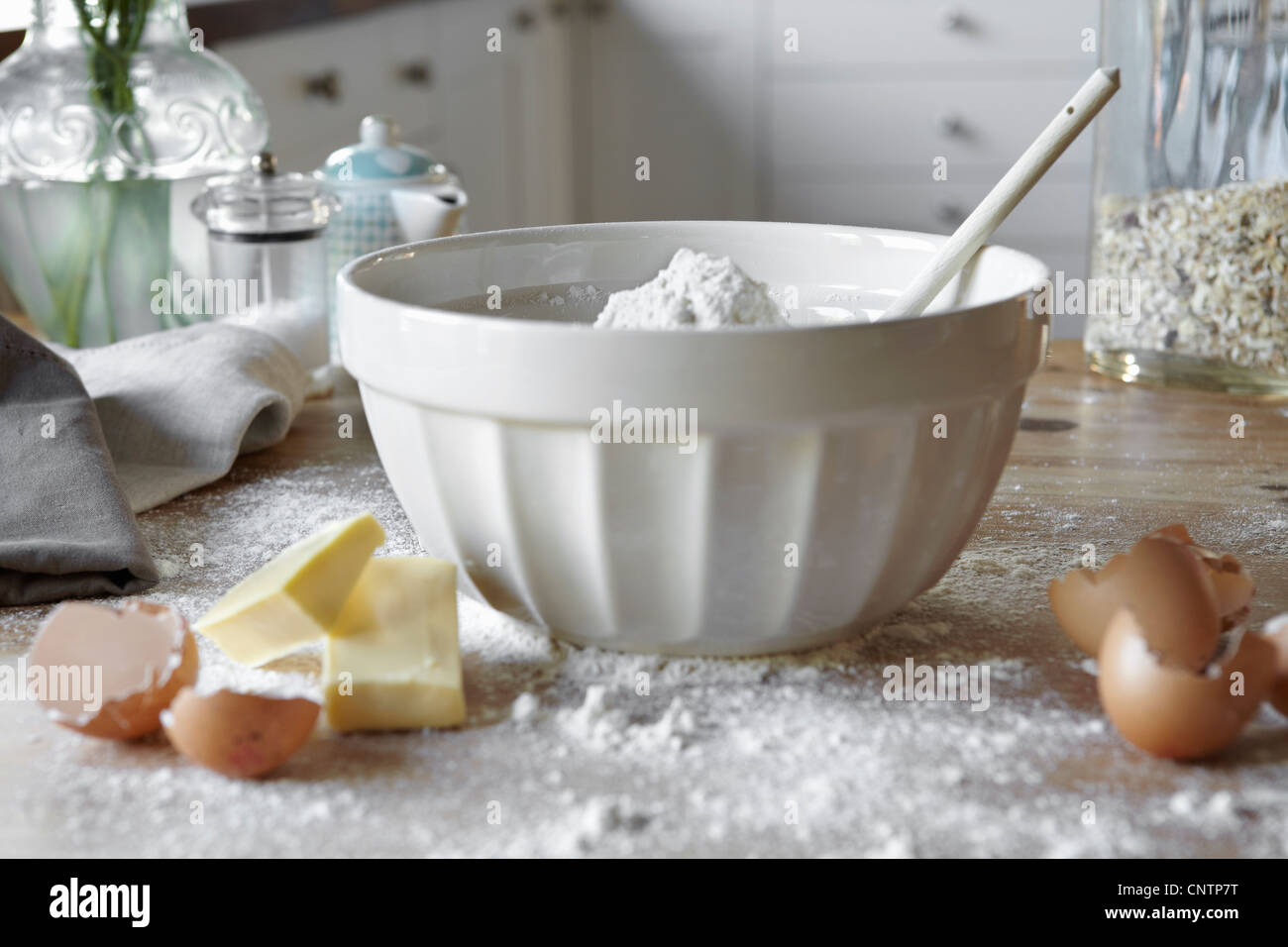 Bowl of mixing dough in messy kitchen - Stock Image