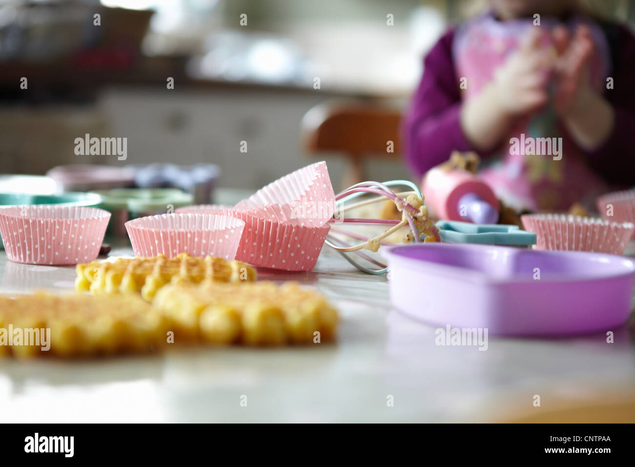 Close up of cupcake wrappers in kitchen - Stock Image