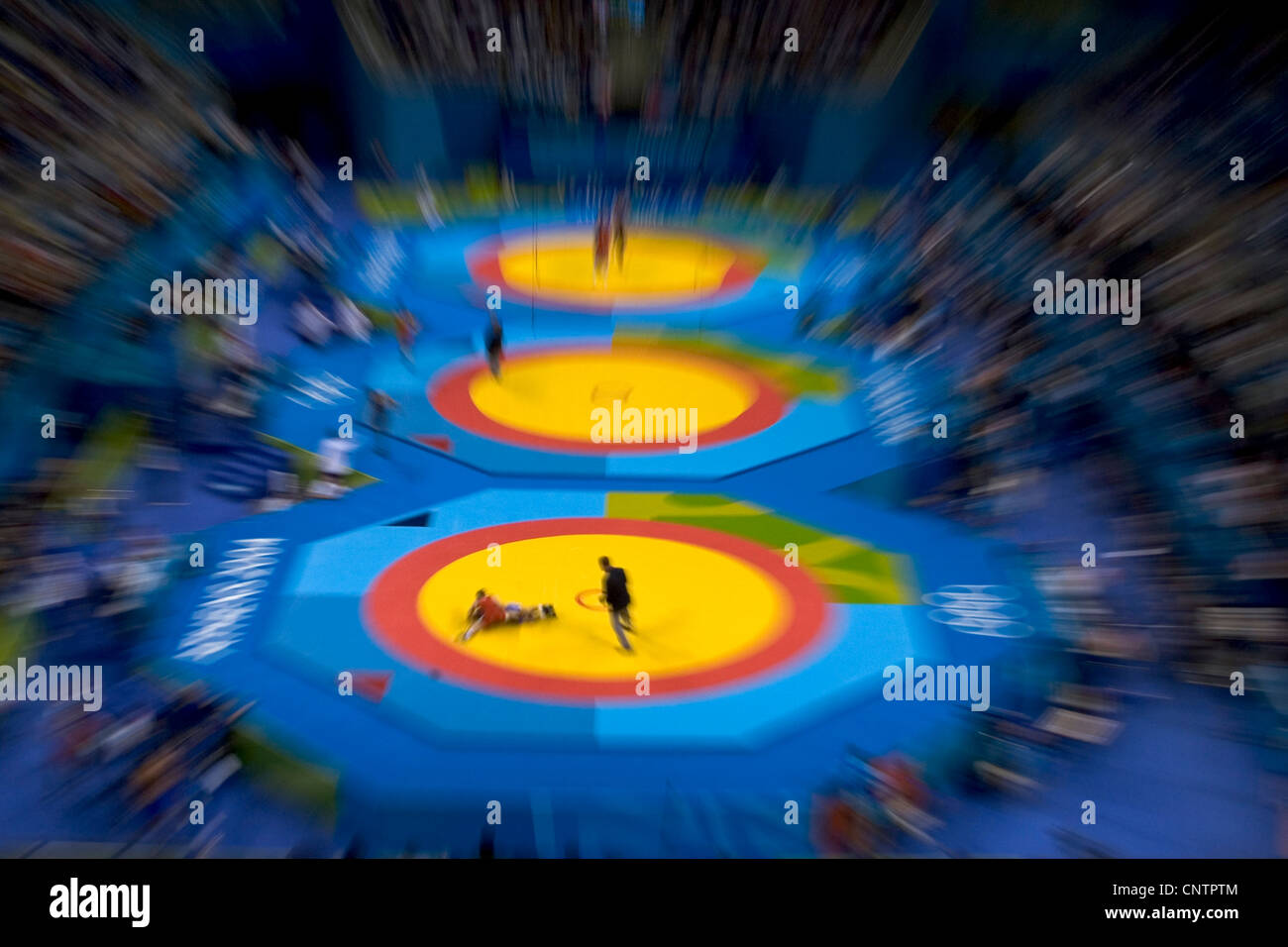 Zoom blur image of Greco Roman wrestlers in action - Stock Image