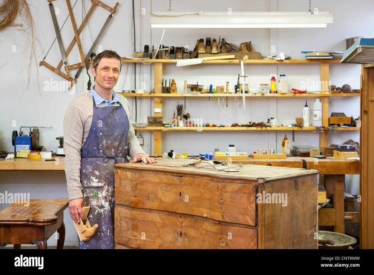 Carpenter working on wooden drawers Stock Photo