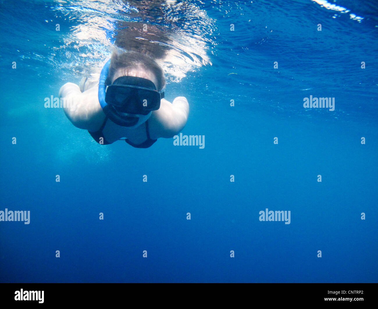 Woman swimming in snorkeling mask Stock Photo