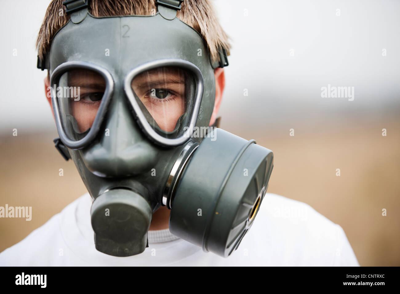 Close up of boy wearing gas mask Stock Photo