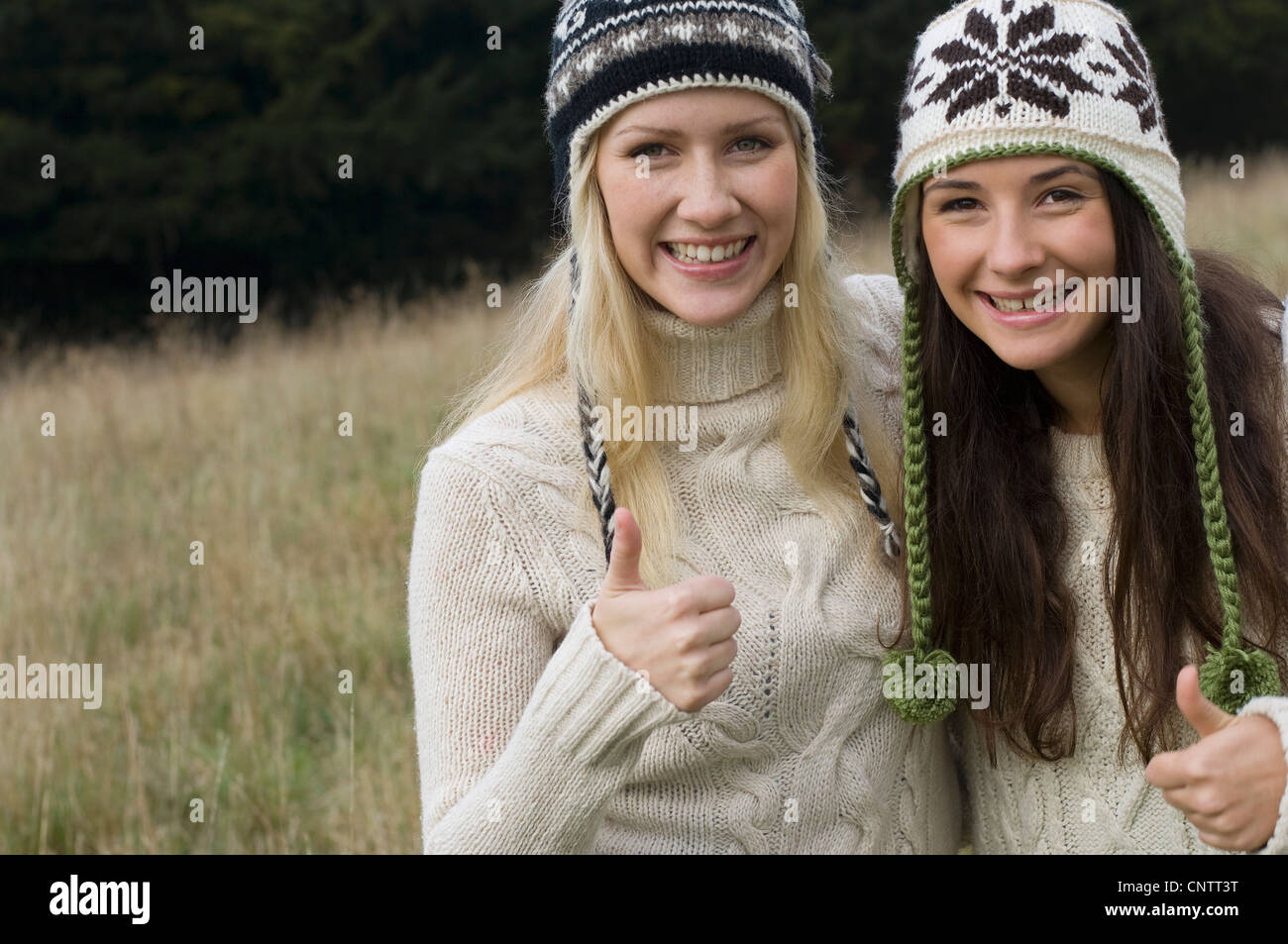 Mother and daughter giving thumbs up - Stock Image