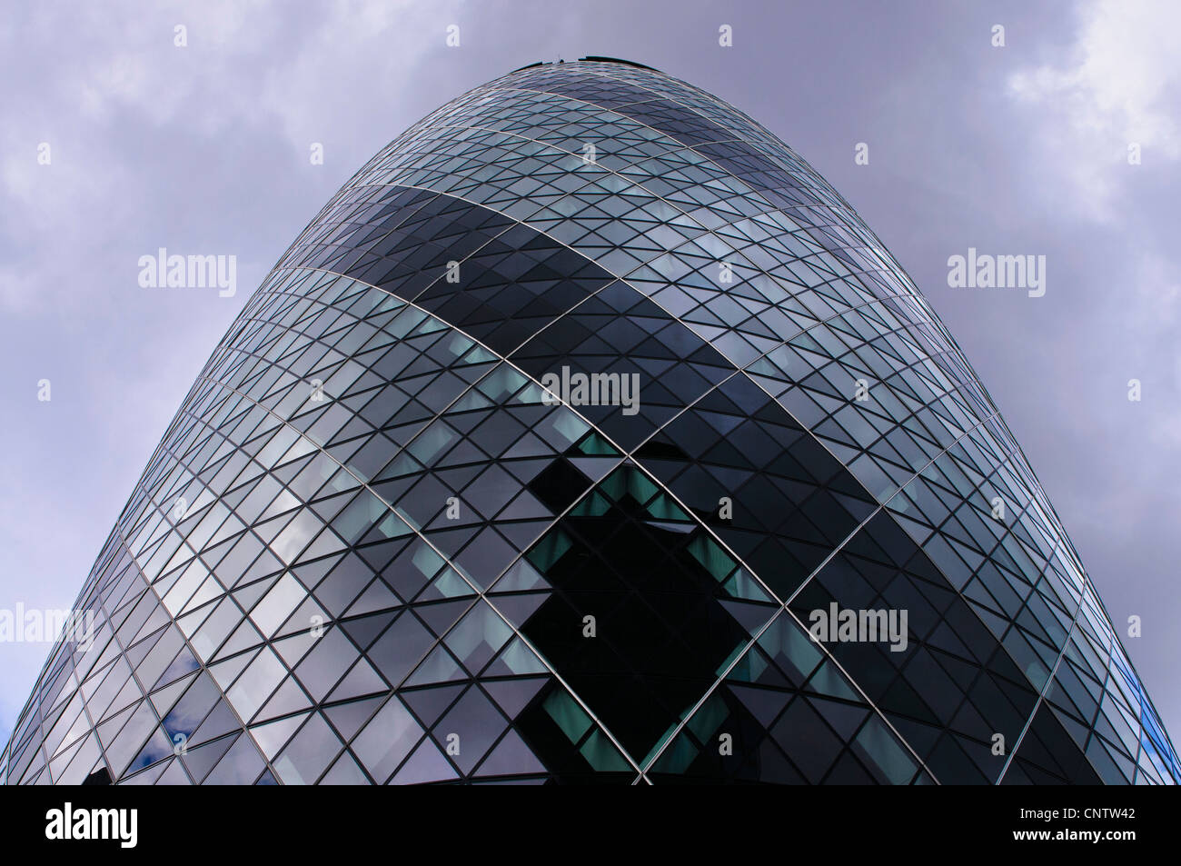 30 St Mary Axe, otherwise known as 'The Gherkin' has a complex, curved exterior where every window panel - Stock Image