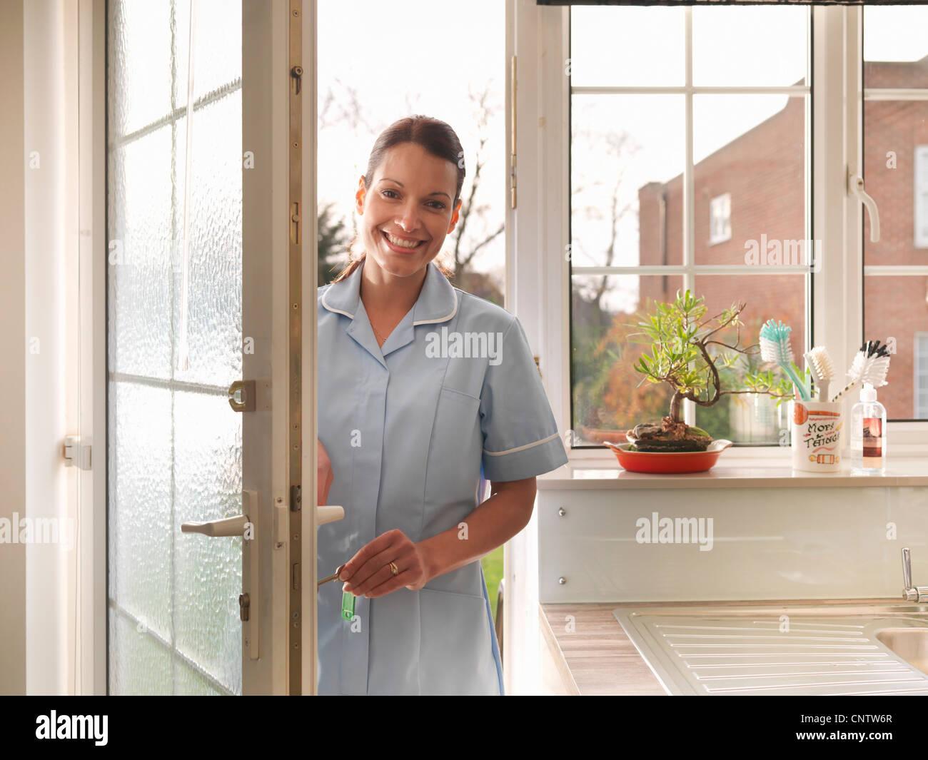 Woman Unlocking The Door Stock Photos Amp Woman Unlocking