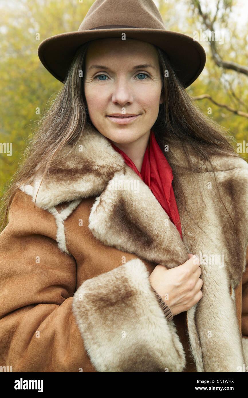 Older woman wearing fur lined coat Stock Photo