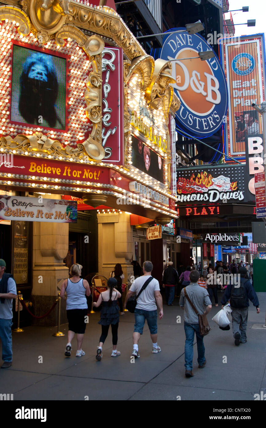 West 42nd Street with its shopping and entertainment is a huge tourist attraction in New York City - Stock Image