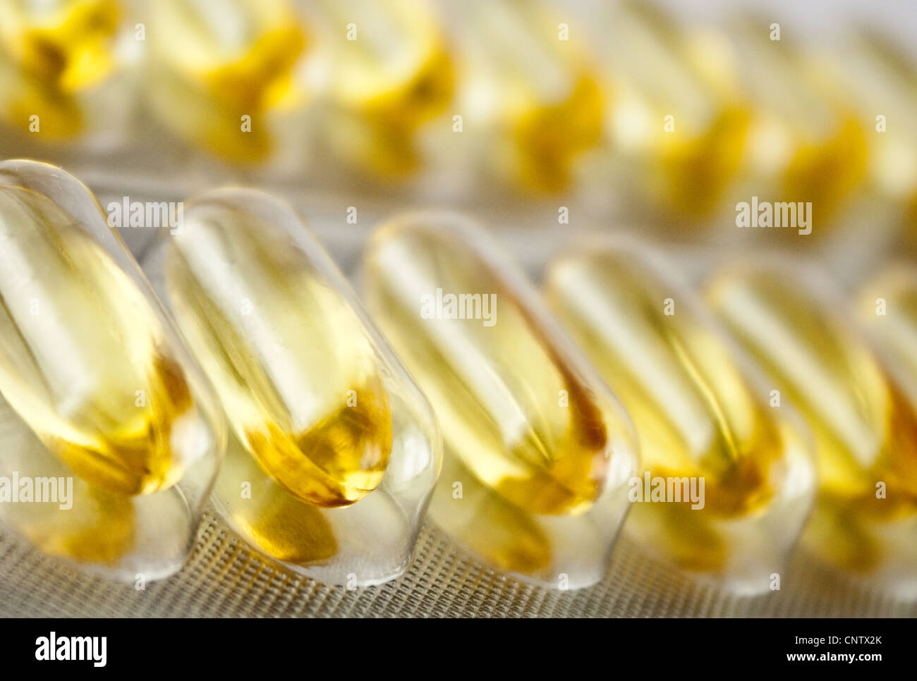 yellow gel pills in a blister - Stock Image