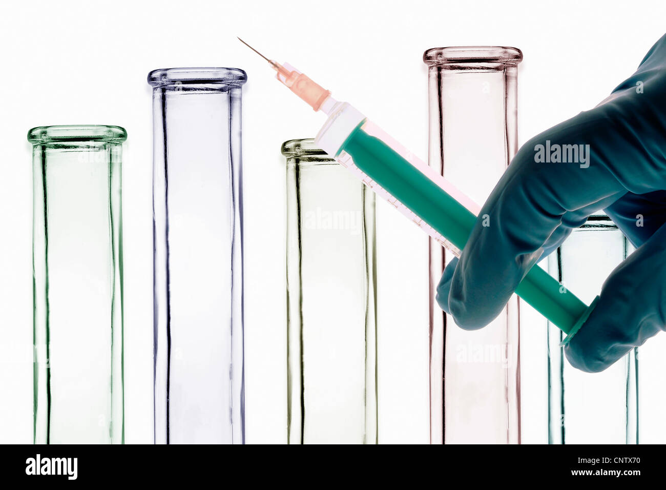 Scientist holding syringe in lab - Stock Image