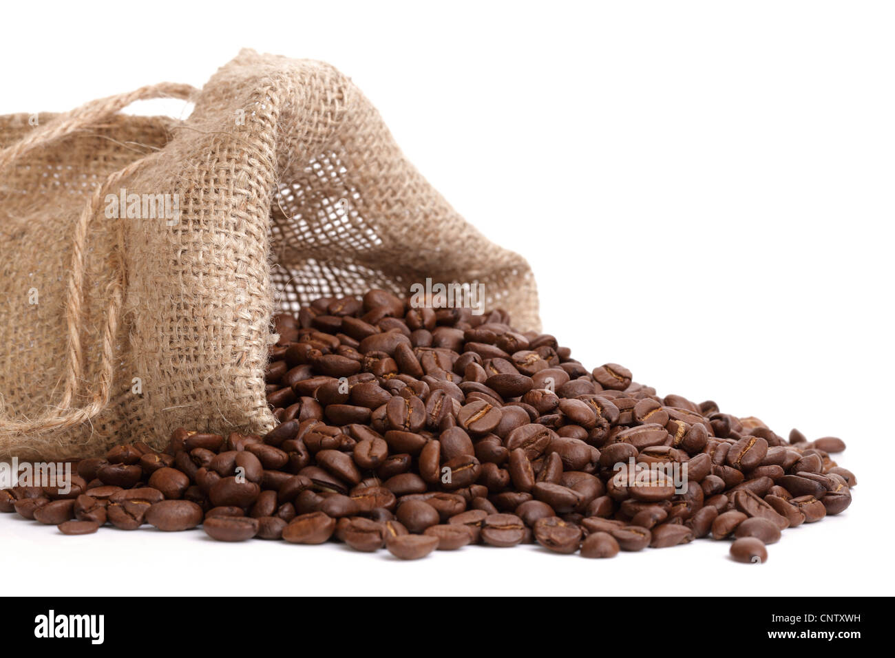 Coffee beans overflowing - Stock Image