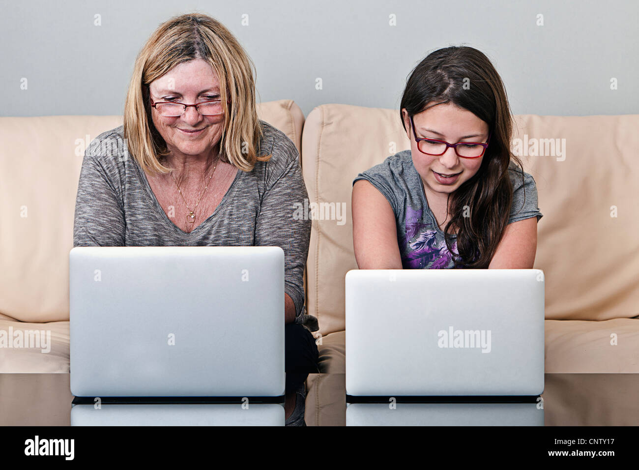 Grandmother and Granddaughter with Laptops Stock Photo