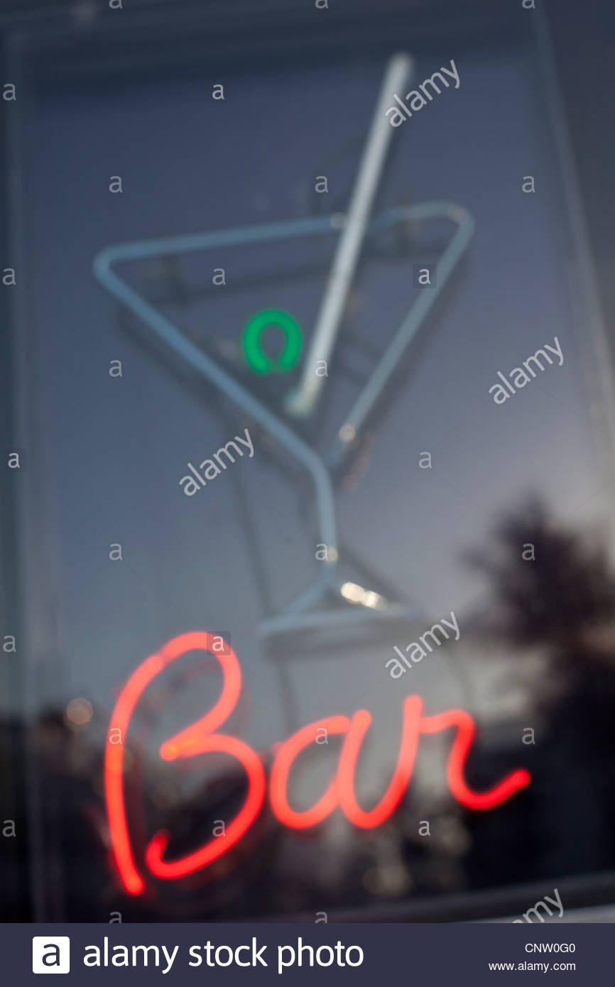 Neon bar sign in window - Stock Image