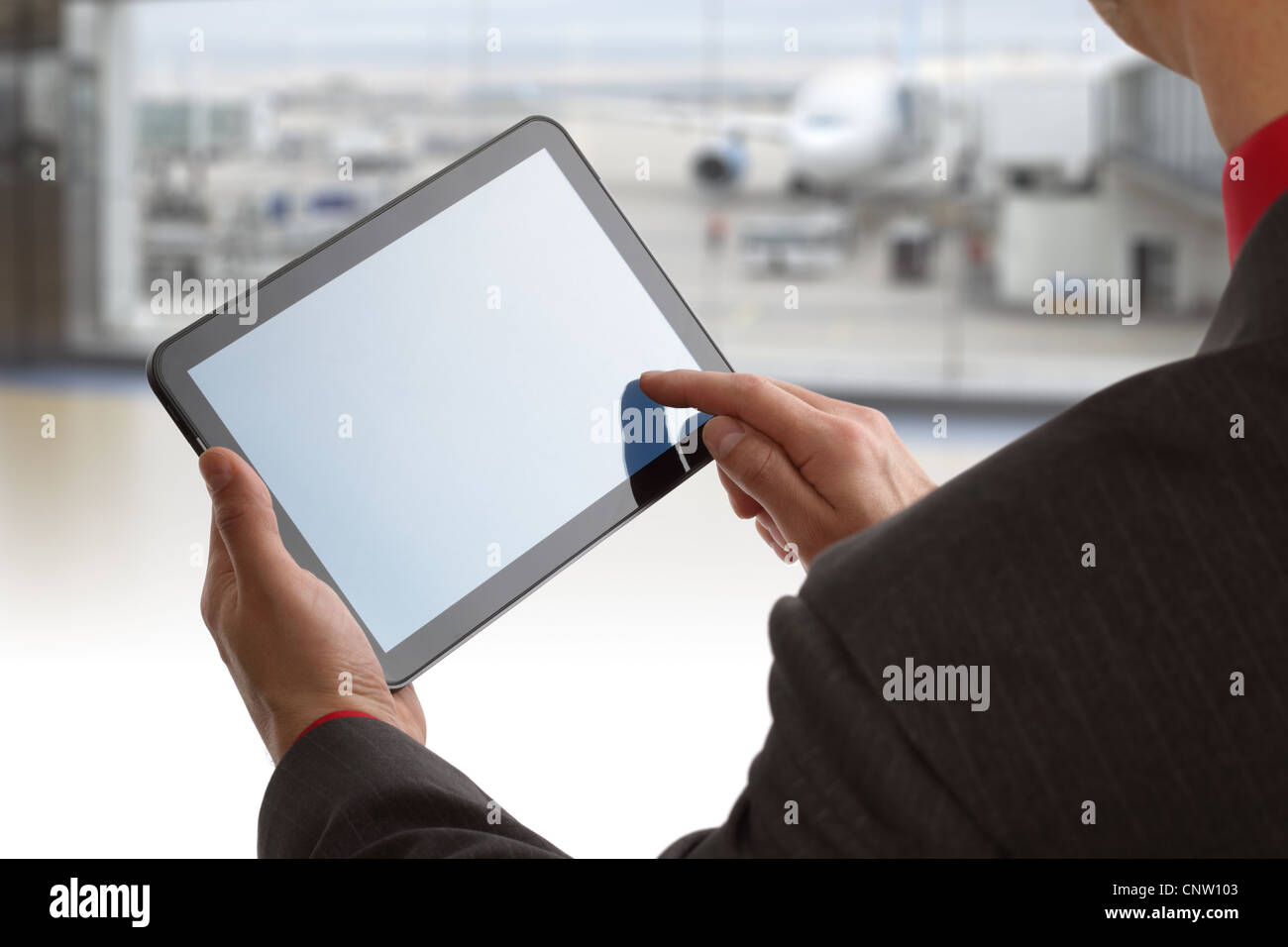 Digital tablet at airport - Stock Image