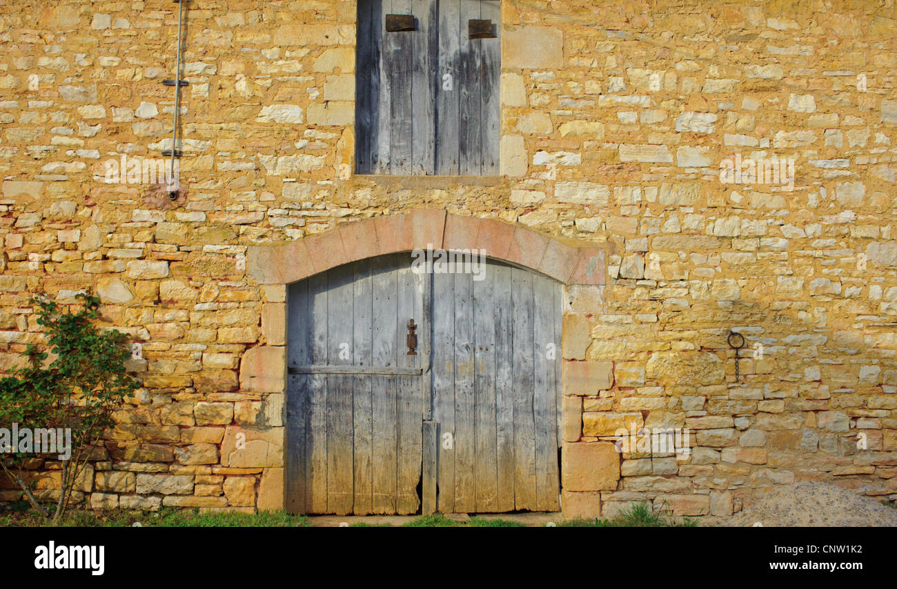 Wooden doors in old French stone barns in southern France - Stock Image