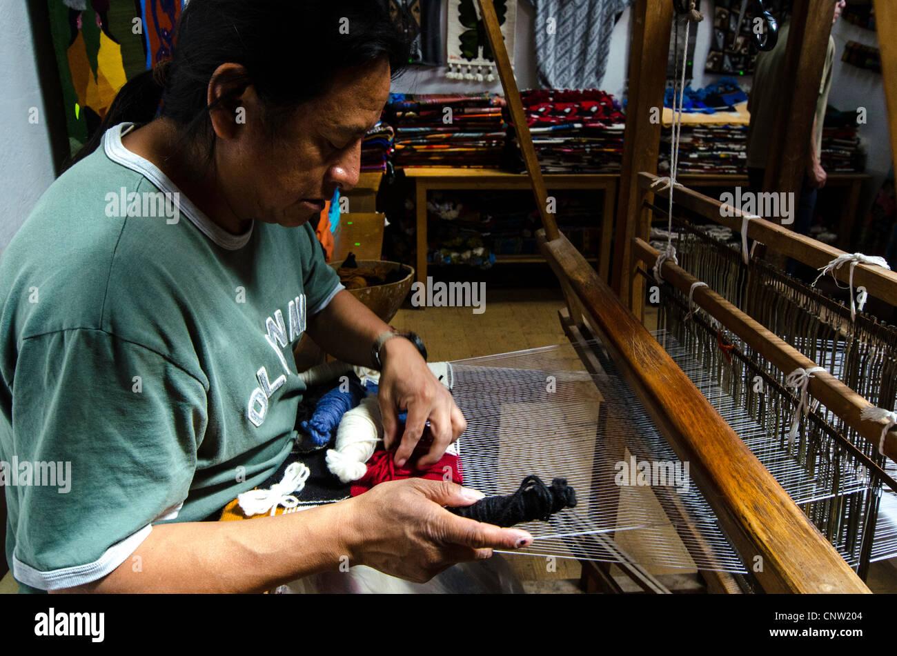 Man weaving Otavalo Ecuador - Stock Image