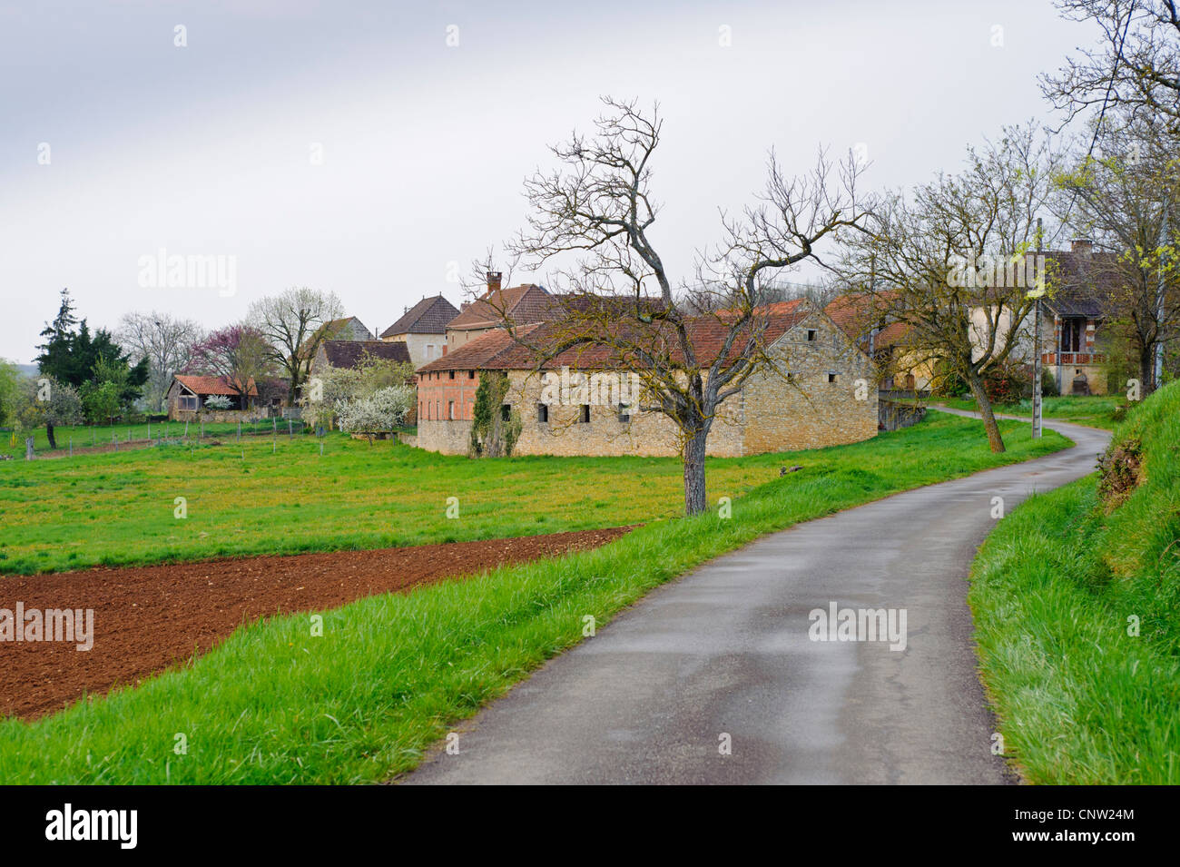 Country road running to small French village in southern France in the Vallée du Lot near Degagnac - Stock Image