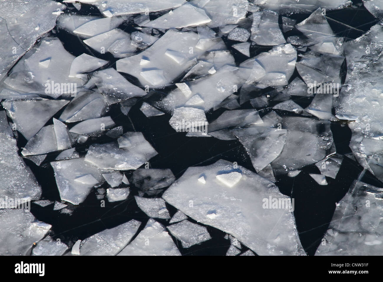 frozen river with chunks of ice - Stock Image