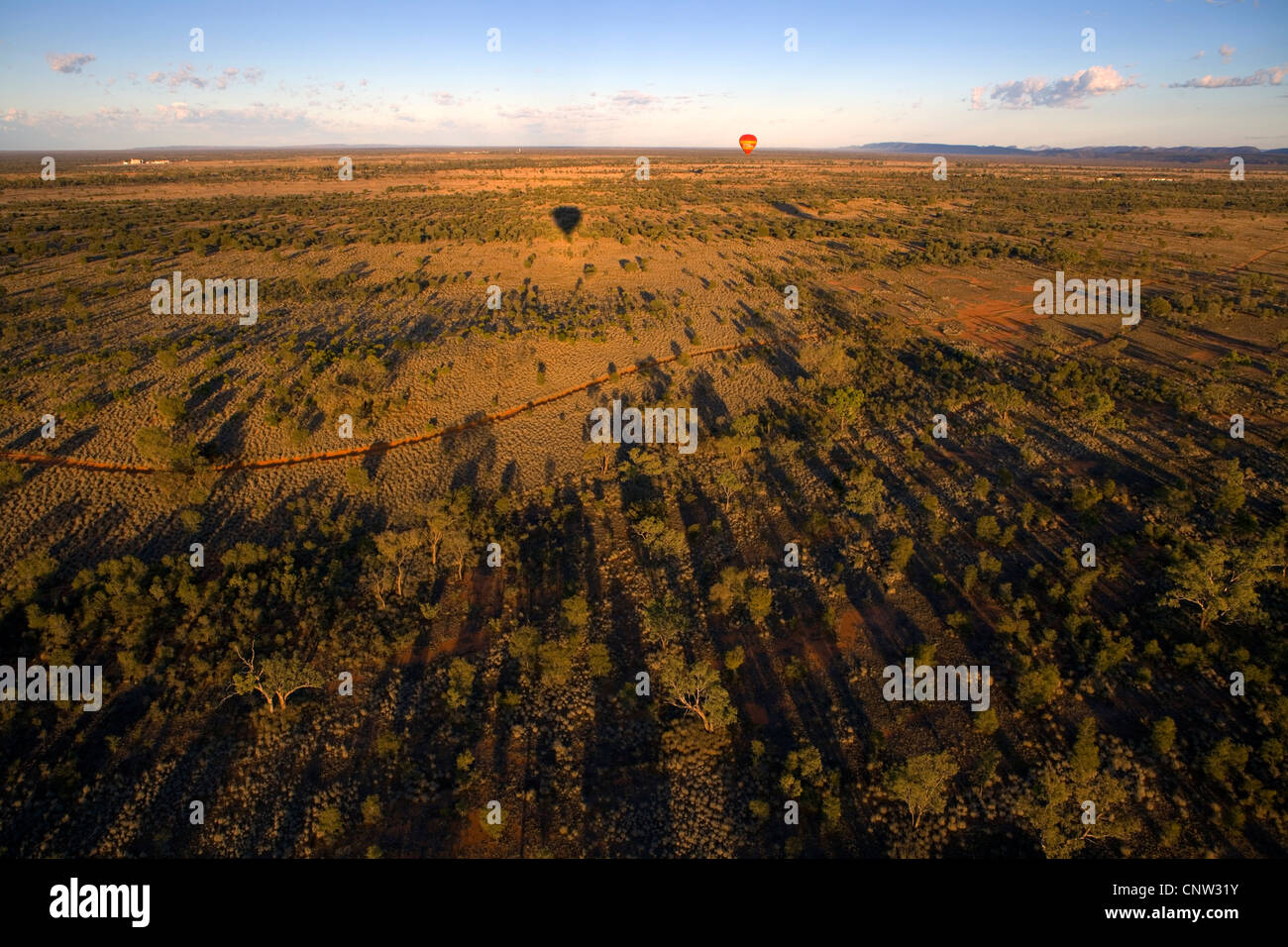 Hot air ballooning over the plains south of the MacDonnell Ranges, Alice Springs, Northern Territory, Australia - Stock Image