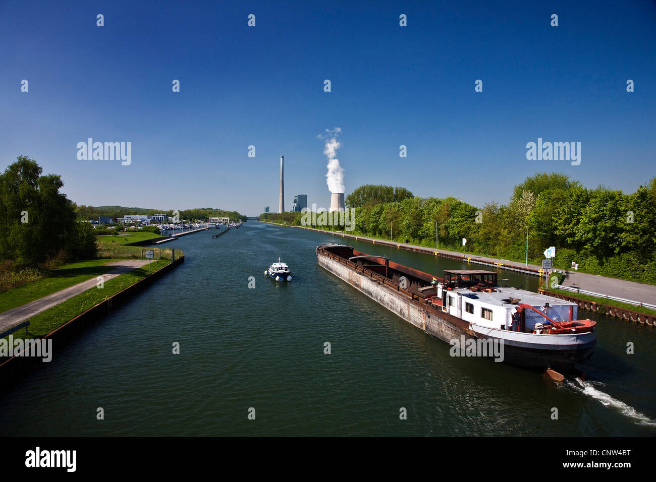 bulk carrier on Datteln-Hamm-Kanal in the background coal-fired power plant in Bergkamen, Germany, North Rhine-Westphalia, - Stock Image
