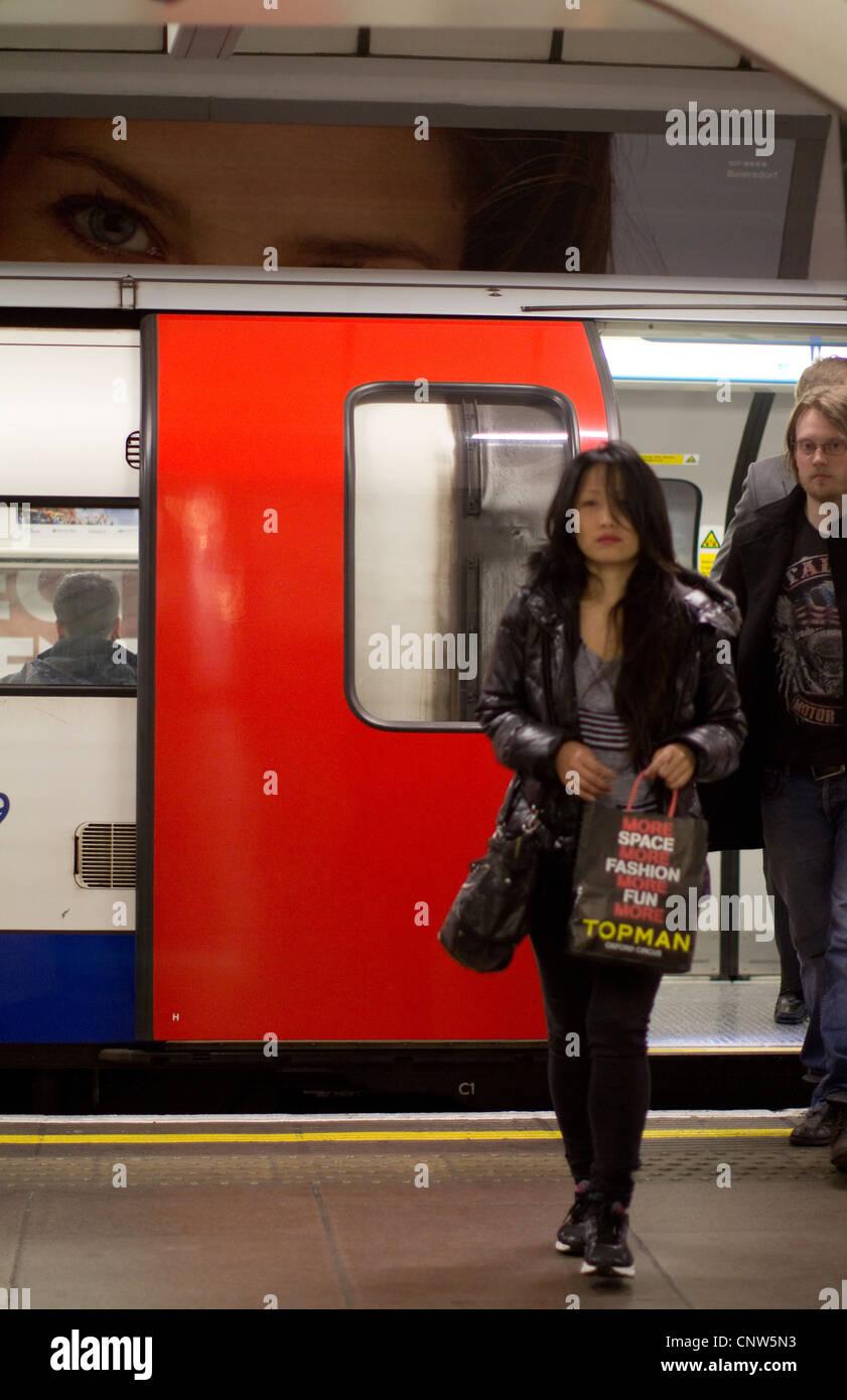 London Underground tube commuters on platform getting off train - Stock Image