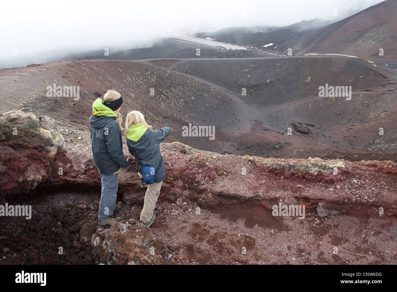 children standing at a volcanic crater of Mount Etna, Italy, Sicilia - Stock Image
