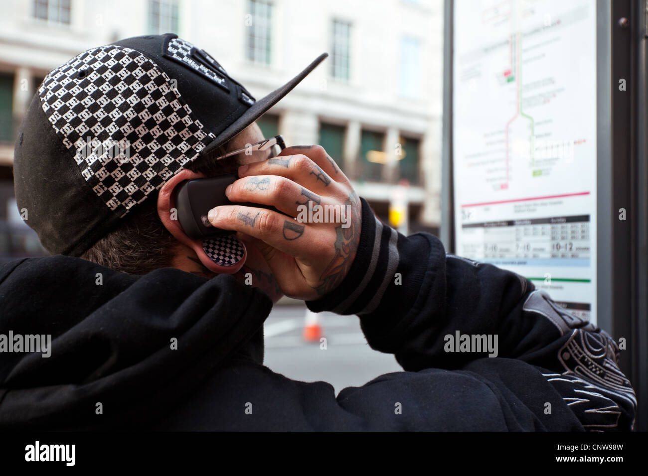 Europe England London, a young man in Piccadilly Circus - Stock Image