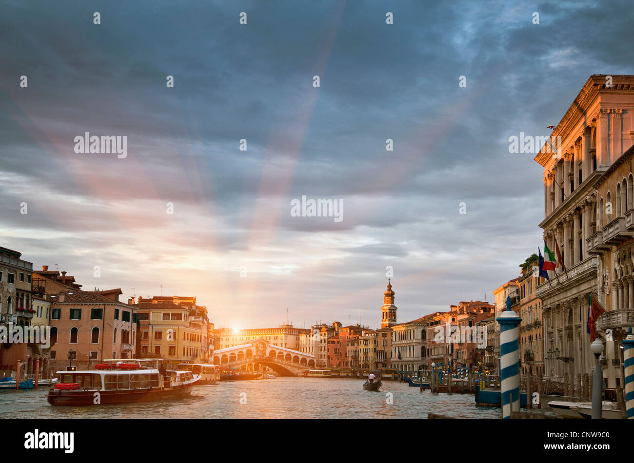 Buildings and ferryboat on urban canal - Stock Image