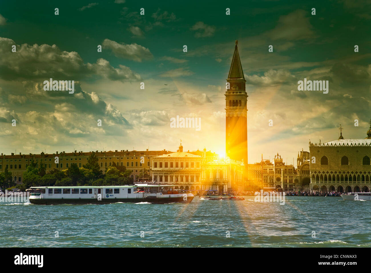 Sun shining through urban buildings - Stock Image