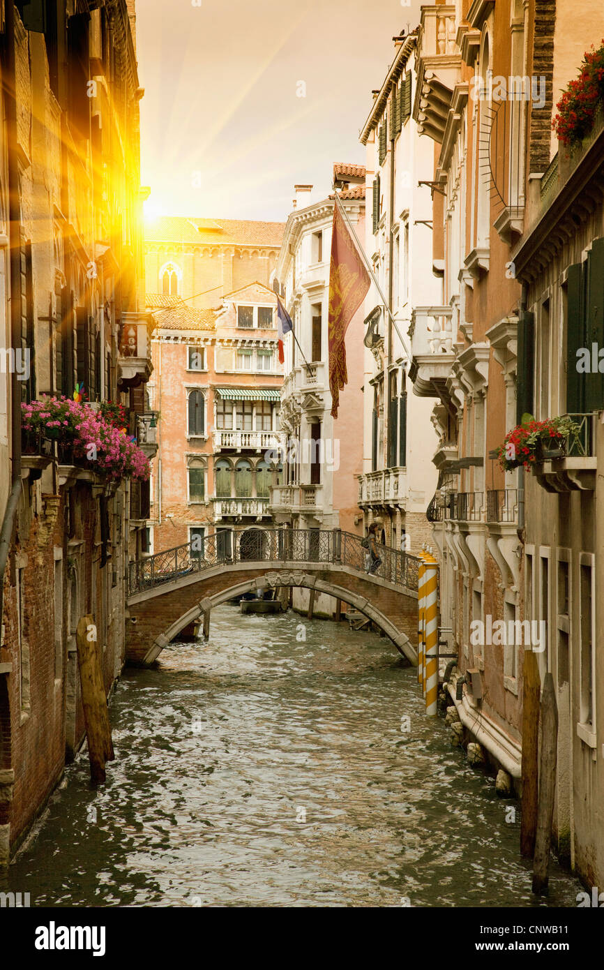 Buildings and bridge on urban canal - Stock Image